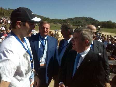 IOC President Thomas Bach meeting Russias first torchbearer Alex Ovechkin during the Olympic Flame Lighting Ceremony